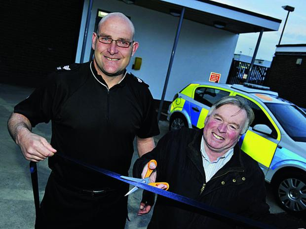 Sgt Colin Travi of Kidlington Police and Cllr Maurice Billington cut the ribbon for the opening of the new front counter at Thames Valley Police headquarters