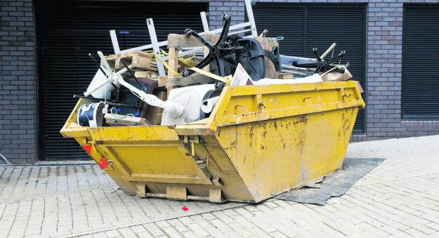 A skip laden with rubbish