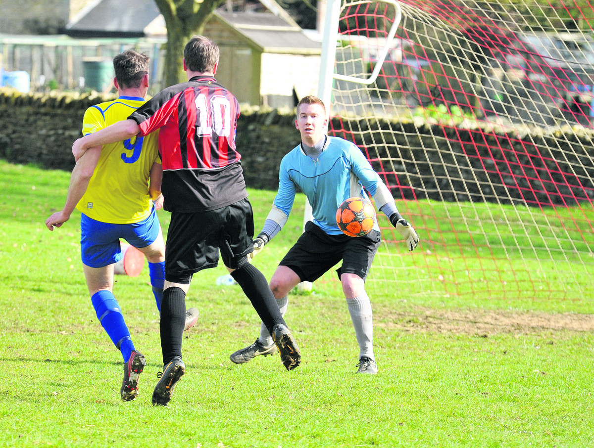 Spartan Rangers' Josh Grant finds the target despite Dan Frizzell's challenge during the 2-2 draw at Brize Norton in Division 1