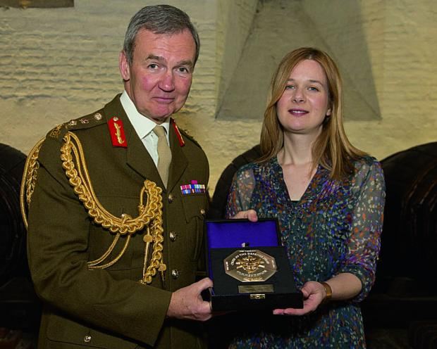 Chief of the Defence Staff, General Sir Nick Houghton, and Holly Davies, Felix Fund's chief executive, with the commendation