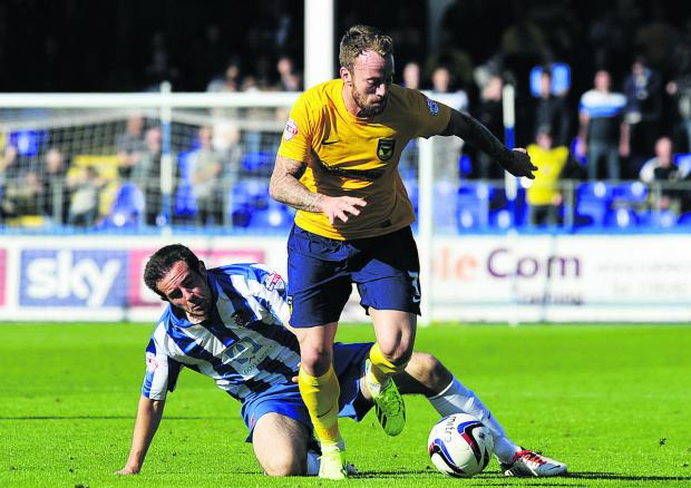 Oxford Mail: Sean Rigg gets clear during the 3-1 win at Hartlepool United in September