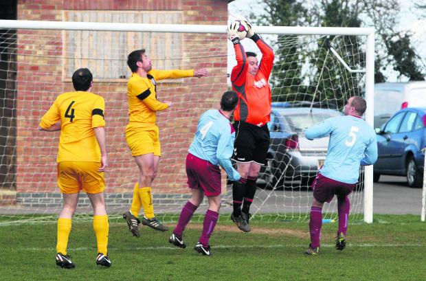 Bletchingdon goalkeeper Nick Lacey is first to the ball
