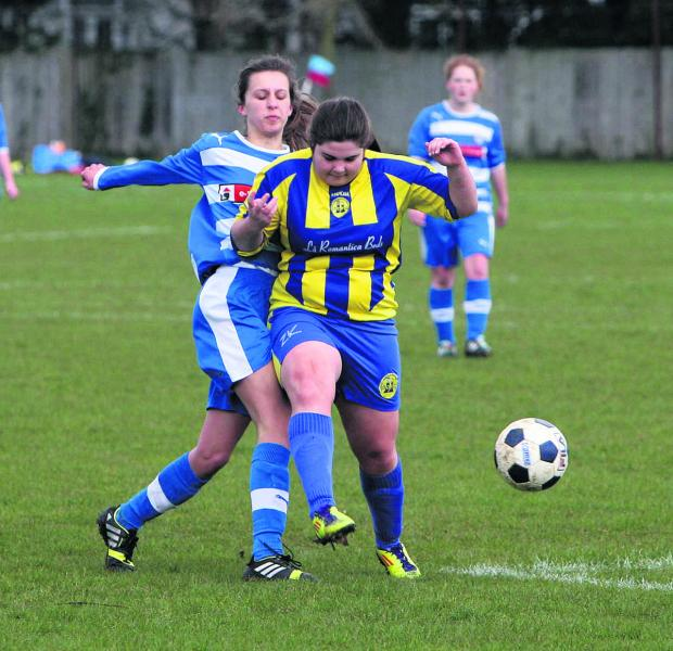 Didcot under 15's Isla Nugent (left) gets in first to deny Oxford City's Lauren Page