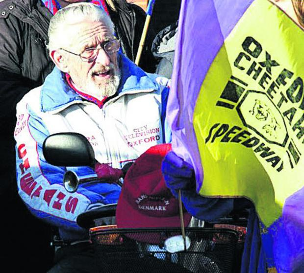 INVOLVED: Norman 'Nobby' Hall pictured with an Oxford Cheetahs speedway flag