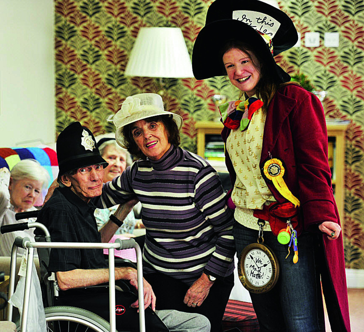 Brian Fox, Barbara Goodwin and Mad Hatter Mary Glaspole at the care home in Iffley     Picture: OX66066 Mark Hemsworth