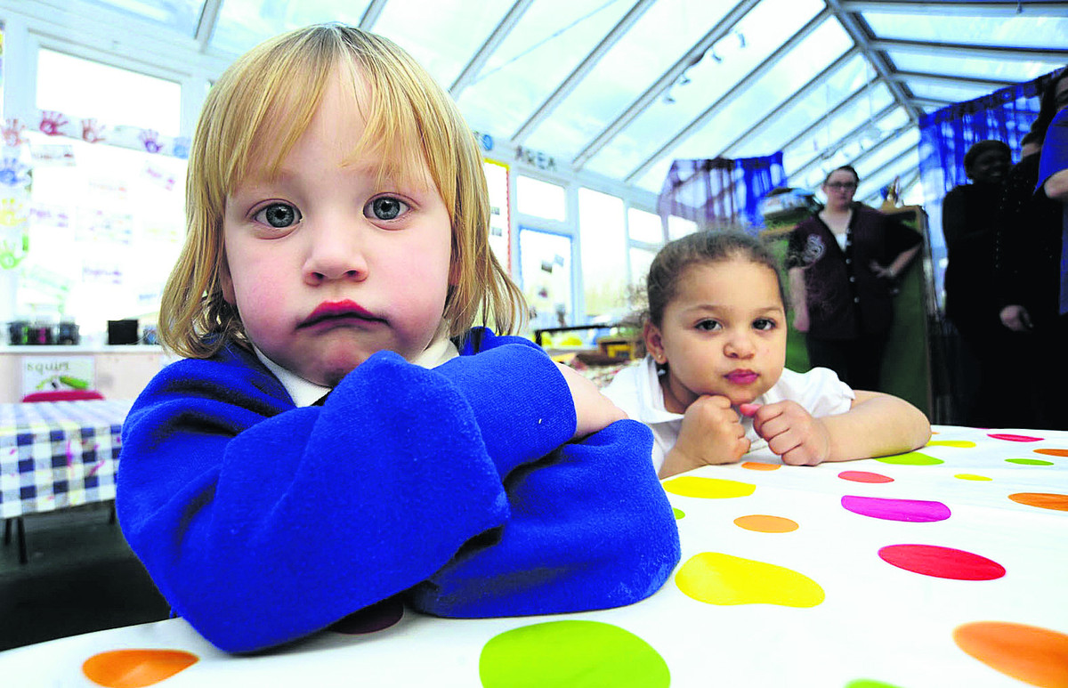 Two-year-olds Harlen Arbour, left, and Amalia Dyer,