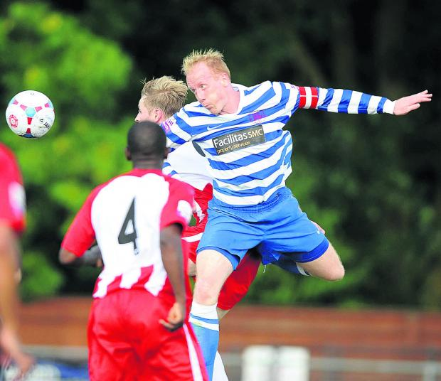 Oxford City defender Andy Ballard is recalled to defence when they host Skrill North   high-fliers Guiseley at Marsh Lane tomorrow