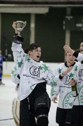 A champagne-drenched Oxford City Stars coach Darren Elliott lifts the ENIHL South Division 2 Cup