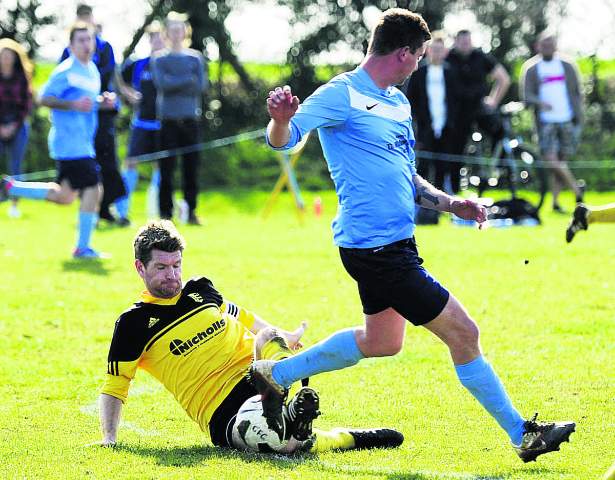 Chris Johnson wins possession for Launton, tackling Chalgrove's Paul Coles Pictures: David Fleming Order no: OX66260