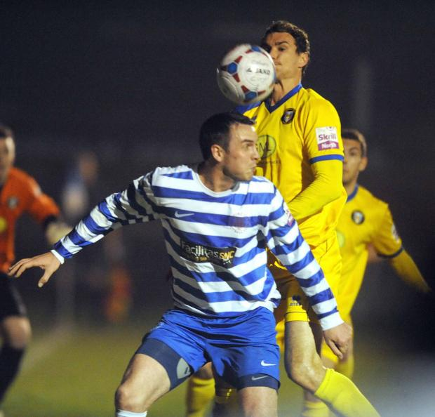 Oxford City's match-winner Mark Preece heads the ball on from a first half corner