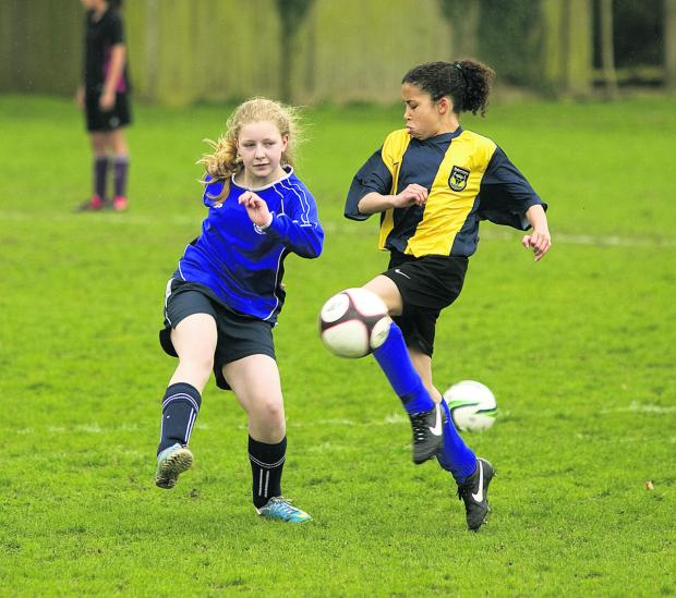 Oxford Mail: St Gregory the Great pupil Elyse Thomas-Collaire, right, in action against Zosia Pears, of Cherwell School