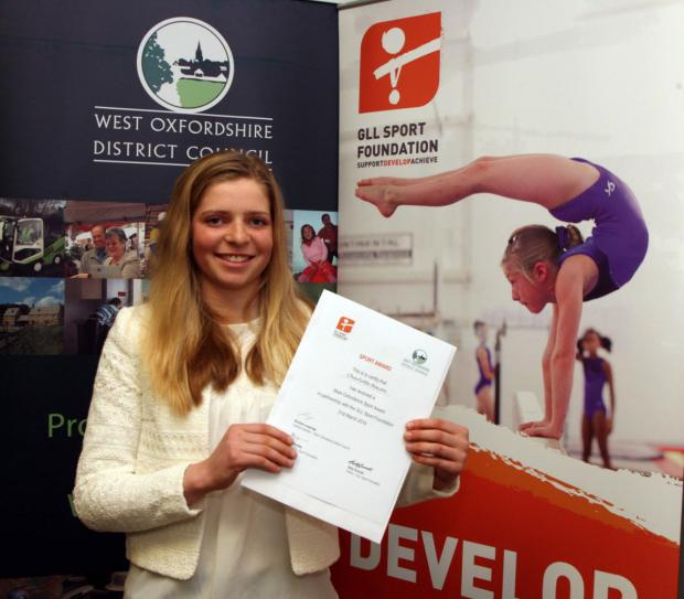 Charlotte Bacon shows off her world-class award