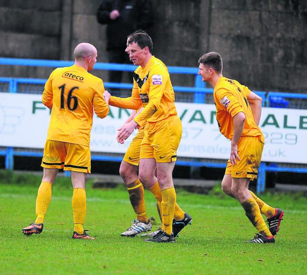 Oxford City scorer Chris Willmott (centre) is congratulated by Tom Winters (left), whose cross created the defender's late equaliser against Stalybridge