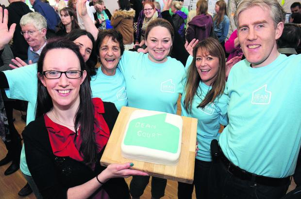 Oxford Mail: Anna Pearson, front, and members of the Dean Court Community Association with a celebratory cake