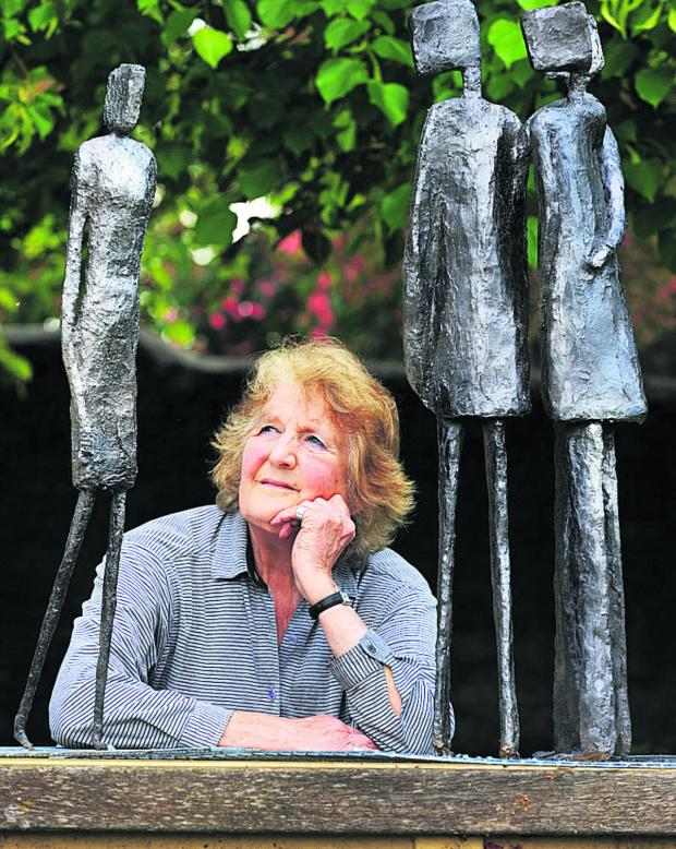 Oxford Mail: Anne Backhouse with one of her sculptures, 'Wowl'