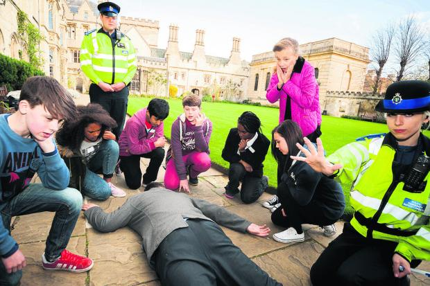 Left to right: Otis Weygang, Ebonie O'Connor, PCSO Tom Baker, Haris Akram-Sheikh, Kian Buck, Lateefat Sodunke, Lauryn Anderson, Olivia May and PCSO Zoe Jenkins surround the body