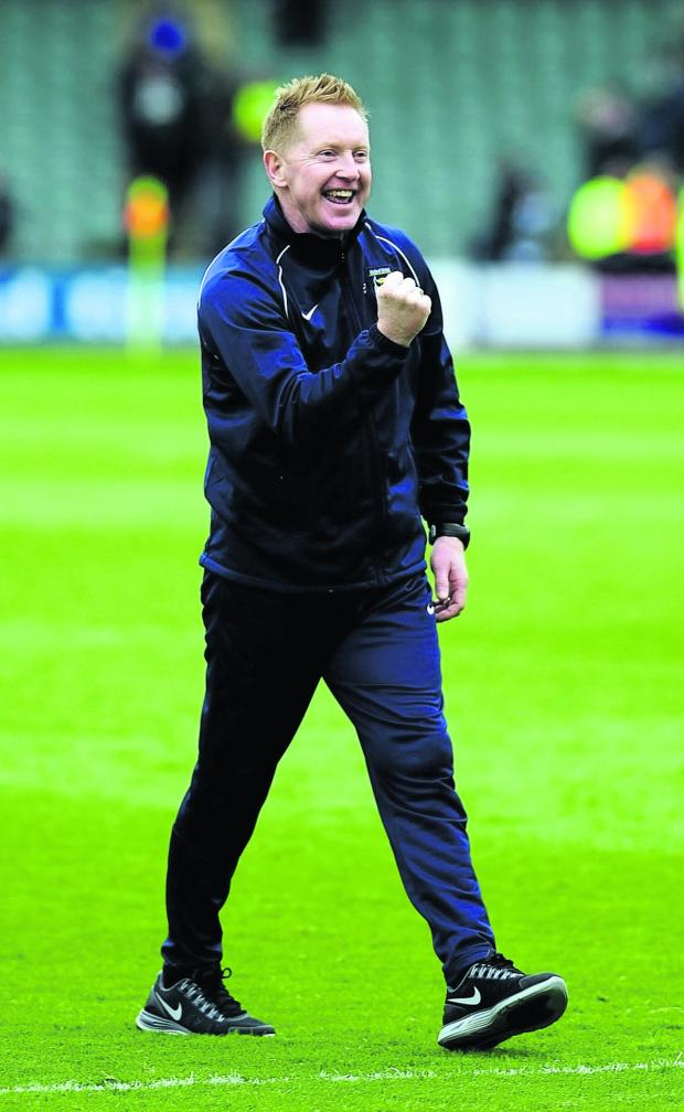 Oxford Mail: Oxford United boss Gary Waddock celebrates with the travelling fans after his side won 2-0 at Plymouth on Saturday