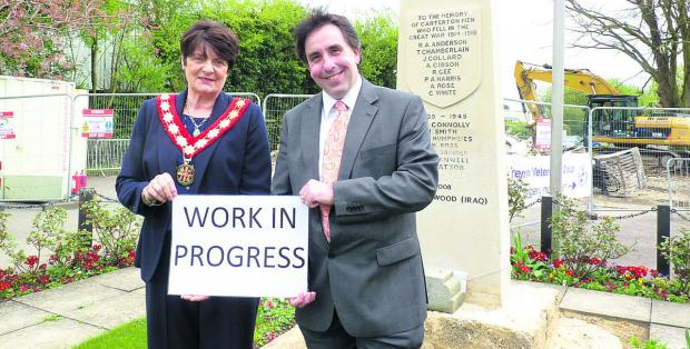 Carterton mayor Lynn Little and West Oxfordshire District Council cabinet member for communities Richard Langridge by the war memorial, which is being cleaned as part of a project to regenerate Carterton town centre