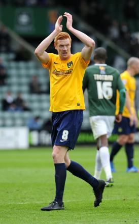Dave Kitson salutes the fans after Oxford United's welcome 2-0 win at Plymouth on Saturday when he scored
