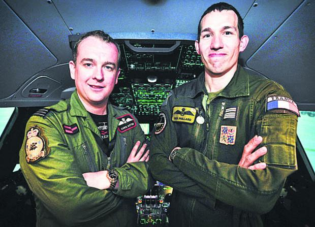 Flt Lt Chris Aston, left, and Lt Col Ben Paillard in the cockpit of the A400M flight simulator