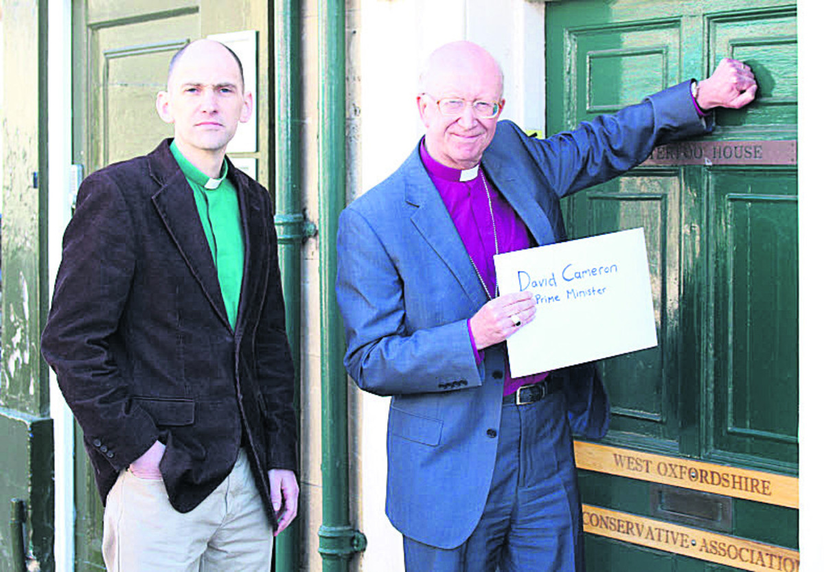 The Rev Dr Keith Hebden, left, and the Bishop of Oxford, the Rt Rev John Pritchard, delivering the letter to David Cameron's office