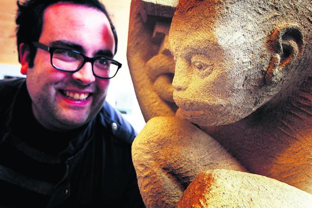 Artist Sean Lynch face-to-face with one of his stone works    Pictures: OX66613 Ed Nix