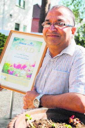 Green Gables Guest House owner Narinder Bhella in his award winning garden which scooped him a gold certificate. Picture: OX62052 Antony Moore