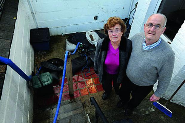 Oxford residents Michael and Maura Dennehy in their flooded Western Road basement when the storms hit