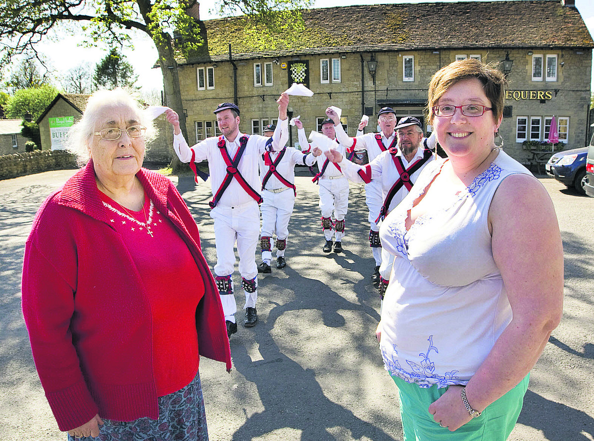 Julie Kimber-Nickelson, left, and Cat Kelly with members of Headington Morris