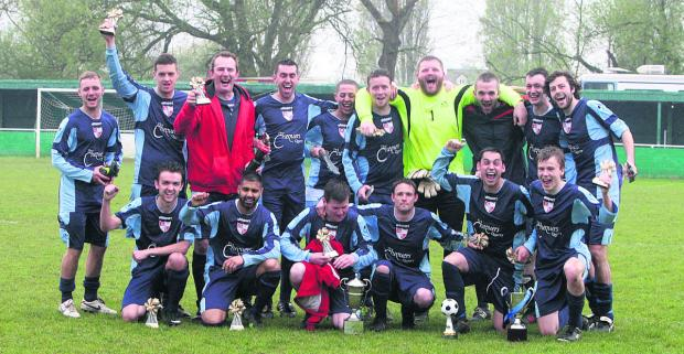 Barton United's squad show their joy at winning the Hedley Toms/Michael Brown Memorial Trophy