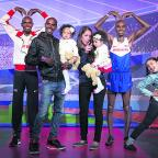 Oxford Mail: Mo Farah, secnd from left, poses with his family, twins Amani and Aisha, wife Tania and step-daughter Rihanna, alongside two wax figures created in his likeness, during a photo call at Madame Tussauds