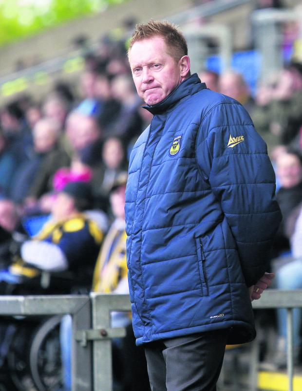 Oxford Mail: Gary Waddock in the dug-out on Saturday
