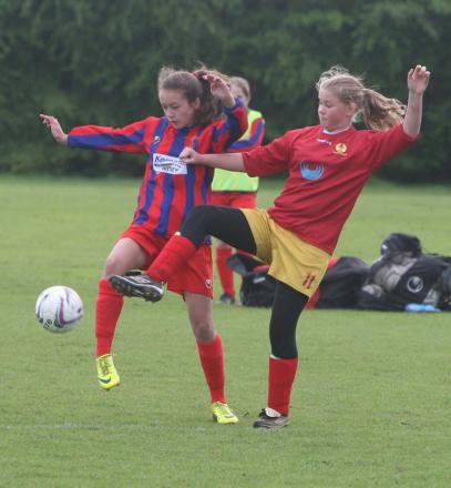 Tower Hill's Lauren Hooper challenges Banbury's Ceirah Bell in their Under 13 League Cup clash