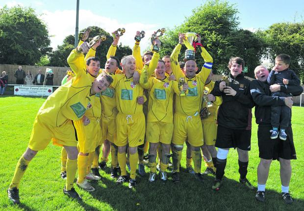 Oxford Mail: Wallingford Town Res celebrate winning the AG Kingham Cup after beating Berinsfield Res 7-2 in the final	 Picture: Denis Kennedy Order no: OX66815