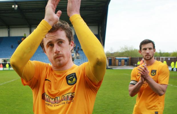 United's Scott Davies (left) and Jake Wright applaud the fans after Saturday's defeat at home to Accrington, but will they be at the Kassam Stadium next season?
