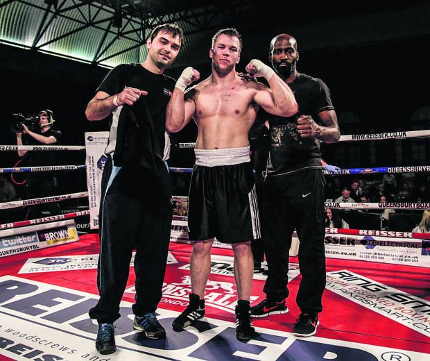 Oxford Mail: Oxford heavyweight Matthew Reeves is flanked by trainer Dennis Hysenbeli (left) and co-trainer Ray Webb after his latest victory