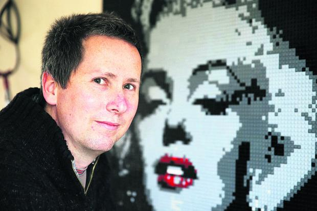 Alastair Howard with his portrait of Marilyn Monroe made of Lego.  Picture: OX66900 Damian Halliwell