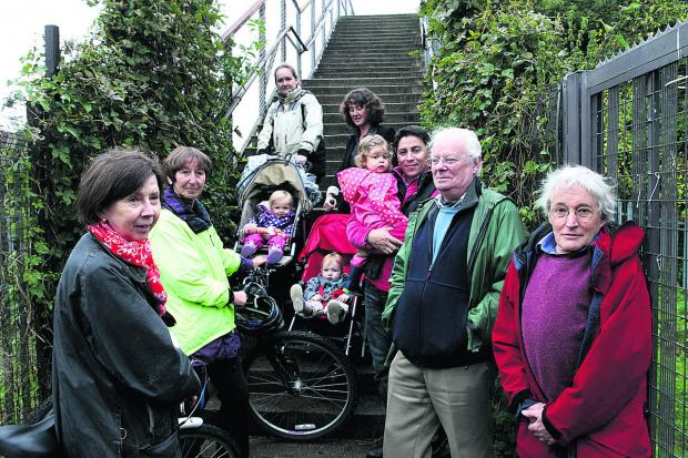 Oxford Mail: BATTLE: Residents who have been campaigning for the bridge to have ramps
