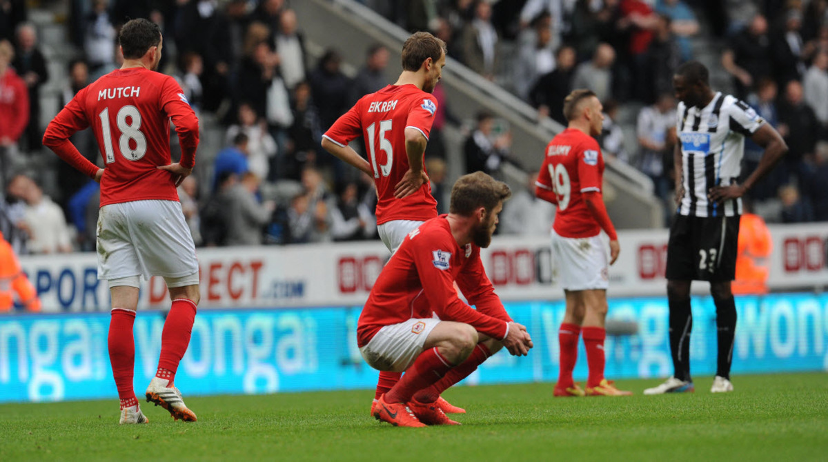 Cardiff players are distraught after their 3-0 defeat at Newcastle confirmed relegation