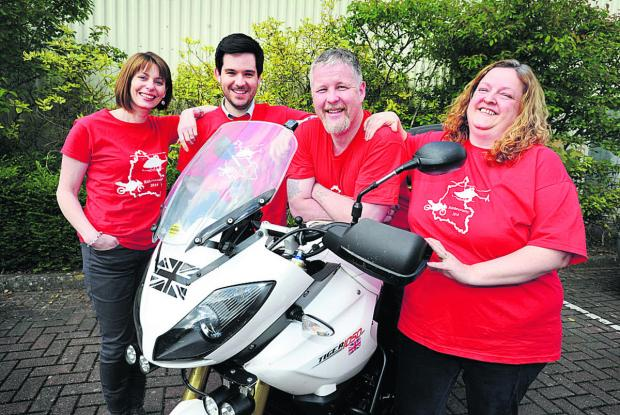 Organiser Paul Long on the bike, with from left, wife Angie, and Shaun Clark and Sharon Ryan who will be manning checkpoints. Picture: OX67012 Jon Lewis