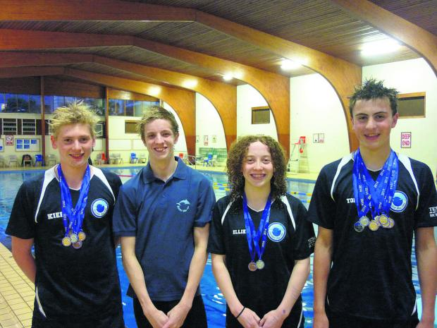 Oxford Mail: Bicester Blue Fins' Ellie Falkner, third from left, stormed to a double victory at Abingdon in the Vale Cup
