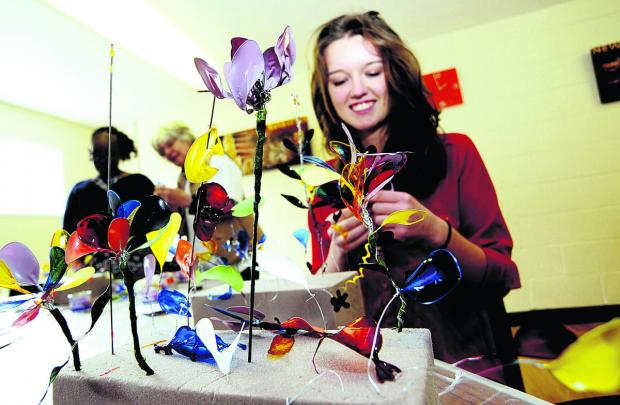 Hayley Wilkinson, 16, has a go at making artificial flowers at the OSCAR event