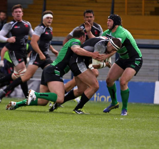 Oxford Mail: London Welsh's Carl Kirwan drives at the Leeds Carnegie defence during the first leg defeat