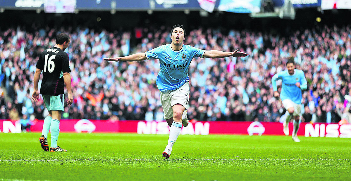 Samir Nasri celebrates opening the scoring on Sunday as Manchester City beat West Ham 2-0 to lift the title