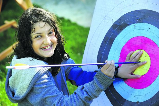 Maya Finlayson, 10, scores a perfect bullseye in the archery session 	      Picture: OX67121 Jon Lewis