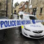 Oxford Mail: Police line do not cross with police car in background