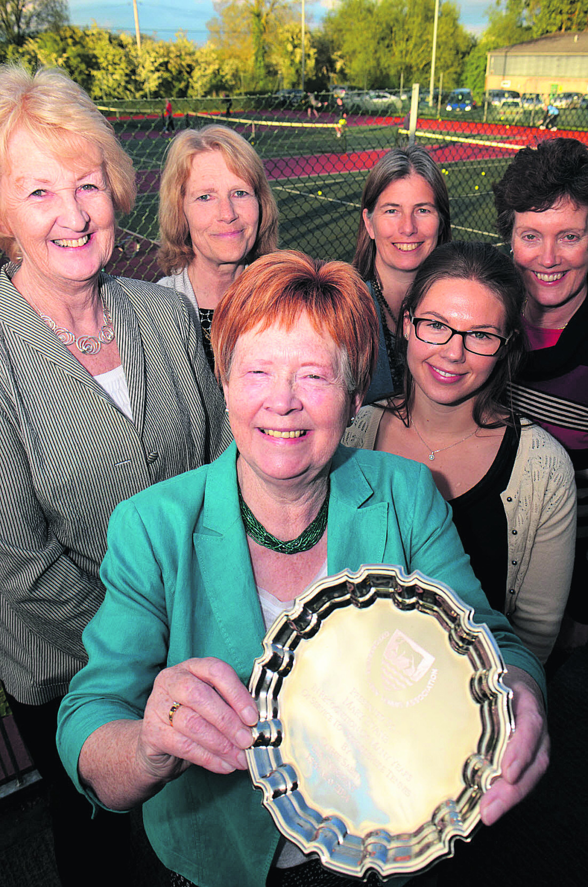 Mary Evans shows off her silver salver for long-service to county tennis. She is flanked by, from left, Lawn Tennis Association president Cathie Sabin and Oxfordshire committee members Nicky Maskens (chairman), Melanie Tonks (coach represen