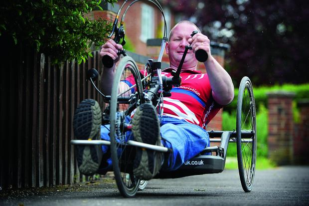 fundraising: Wheelchair marathon man Dave Bracher is taking part in a hand-cycle ride from London to Paris to raise money for the Spinal Injuries Association which is celebrating its 40th anniversary. Picture: OX67145 Jon Lewis