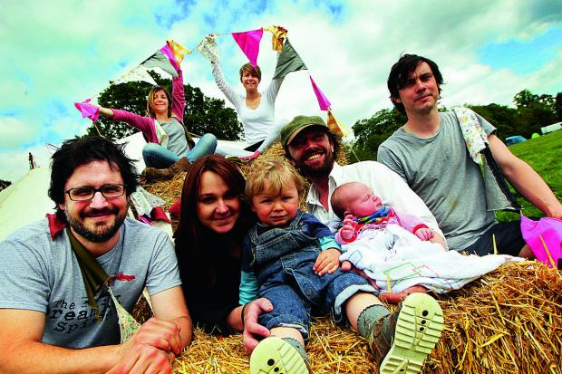 Front, from left, co-founder Joe Bennett, Natasha Carr with Phoenix Carr, Charlie Carr with baby Bearin Carr and co-founder Robin Bennett. Back, Megan Bennett, left,
