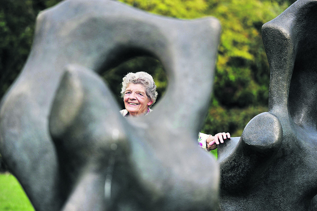 Margaret Plumb with one of the sculptures